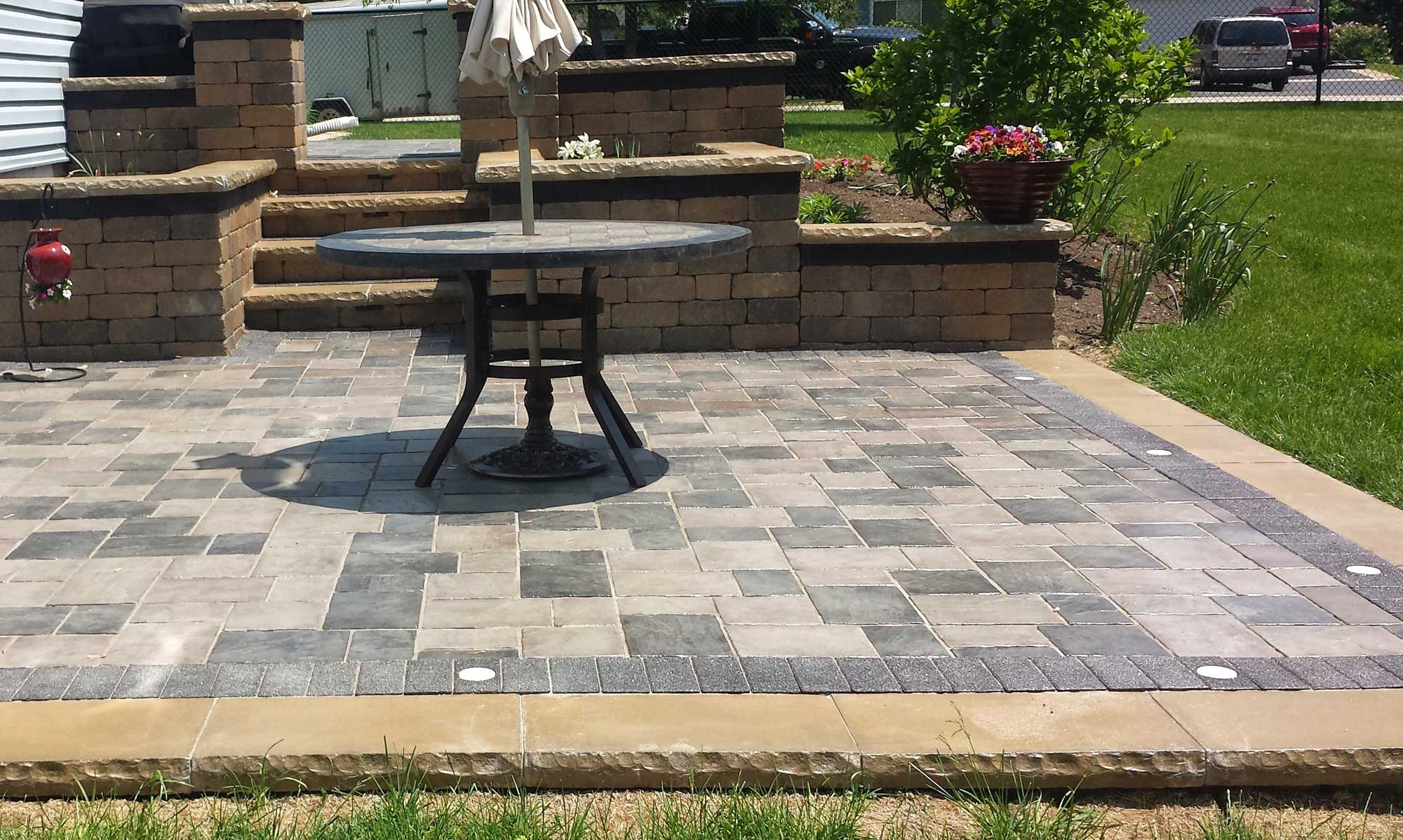 Brick Paver Steps_patio. Curved_walkway_sitting_area.  Unique_shaped_patio_design. Brick_paver_porch_steps_walkway