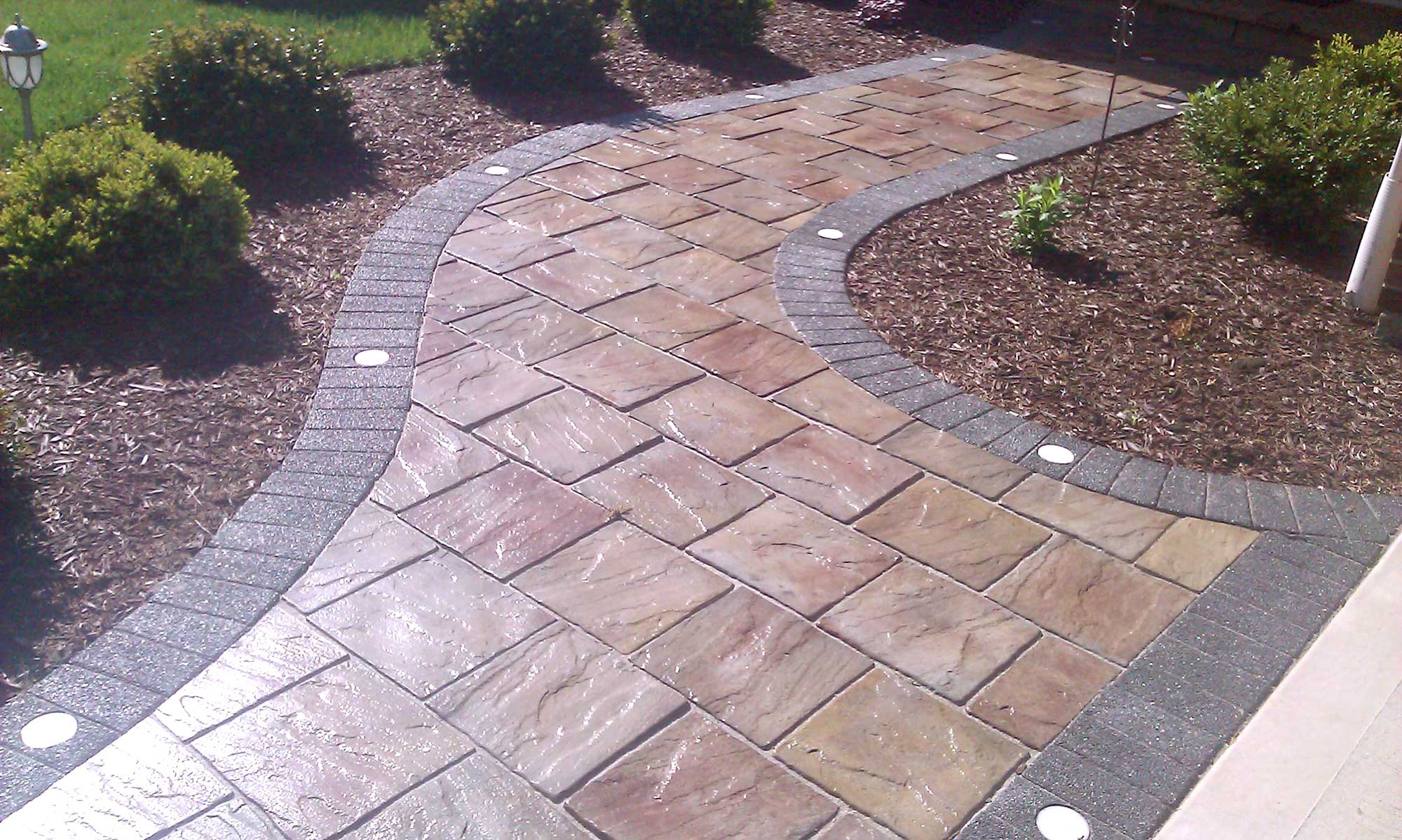 brick paver walkway with inserted lights